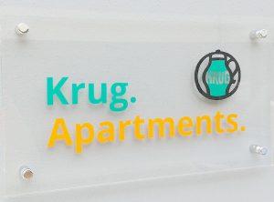 Acrylglasschild | Krug Apartments | Ebelsbach